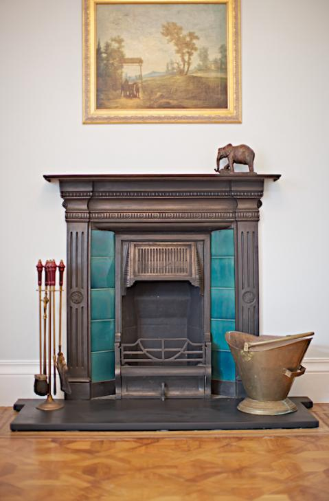 Drawing room fireplace. Private residence, Jersey Channel Islands.